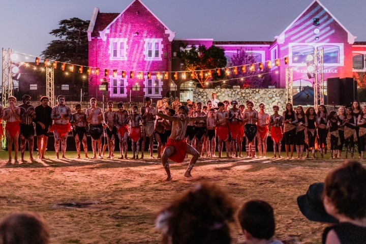 Boy performing an indigenous dance at the Moorditj by Moonlight event at Wesley College